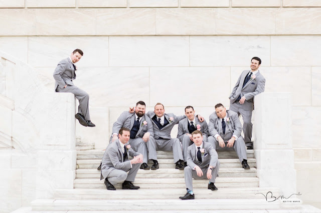 groomsmen on steps at DIA