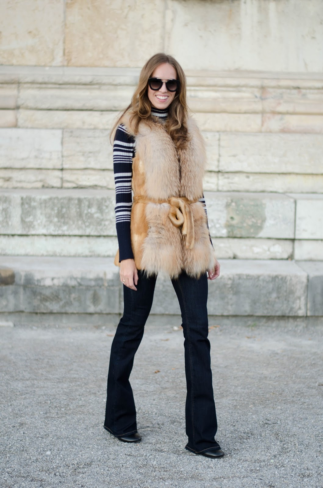 kristjaana mere red fox fur vest striped turtle neck jumper flare jeans fall outfit