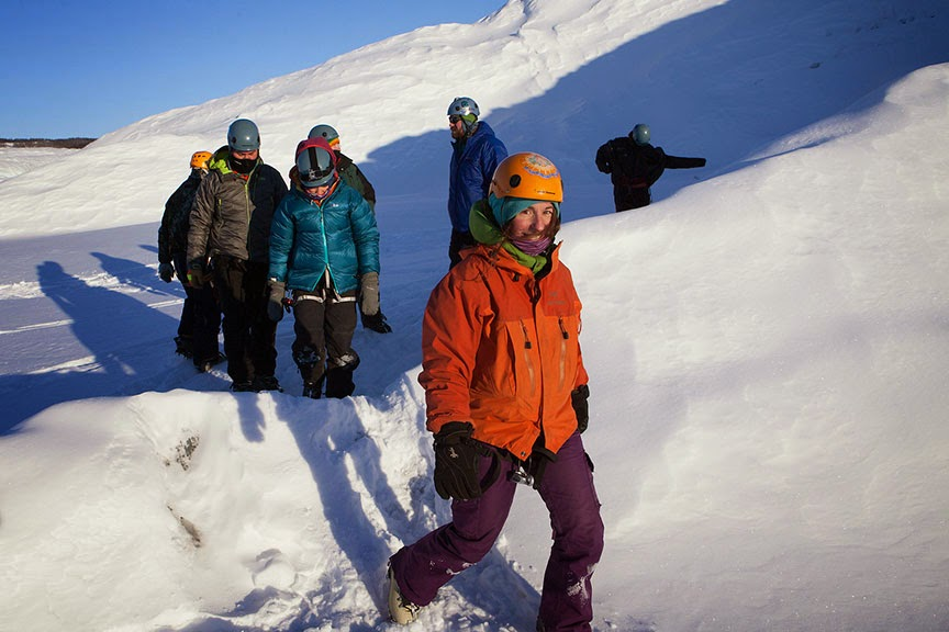 Adjunct professor Amy Beaudoin leads her ice climbing class around the ice wall on Matanuska Glacier