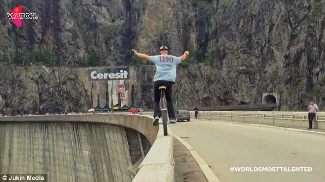 Fearless Cyclist risks life by riding around edge of Romania's tallest dam(Phoos)