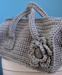 http://www.ravelry.com/patterns/library/crochet-duffel-purse