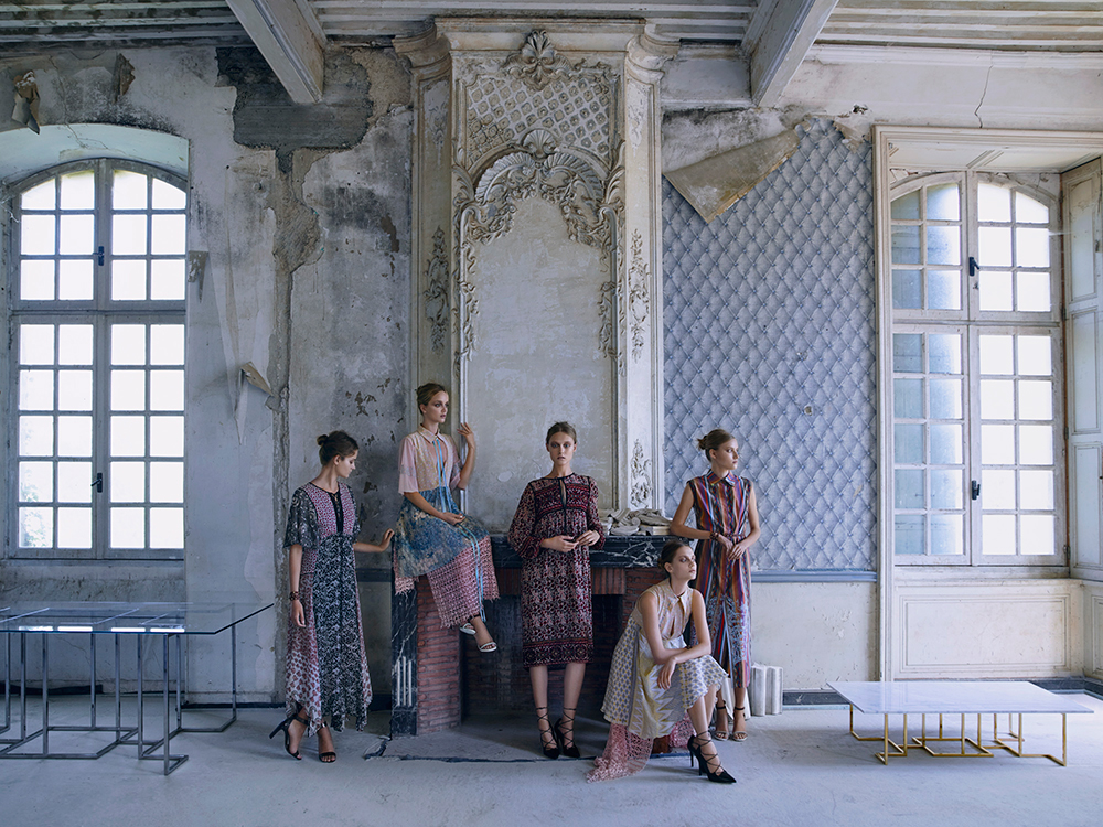 Models in front of peelying wallpaper wall of decaying French Chateau Gudanes