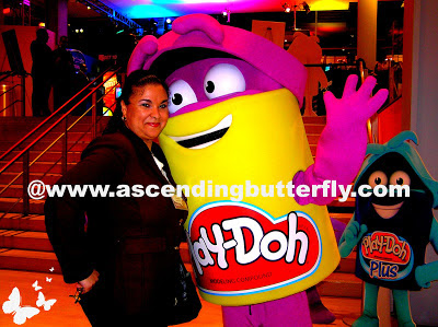 Ascending Butterfly poses with Play-Doh Mascot during Hasbro Toy Fair 2013 Event in New York City