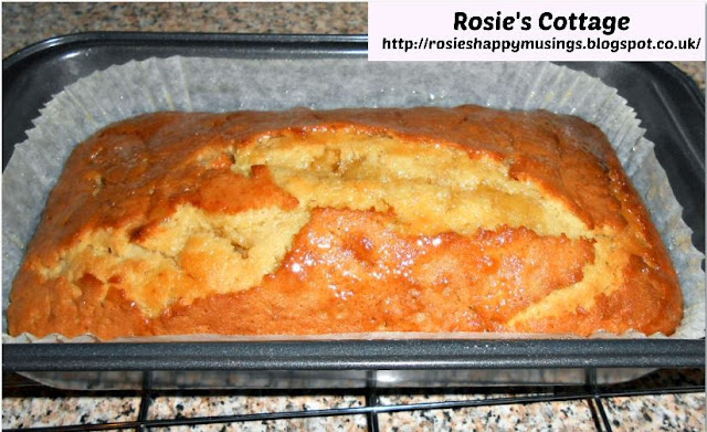 Rosie's Lemon Drizzle Sponge Loaf - gently poke the surface of your sponge with a knife and allow the lemon syrup to sink into the cake.