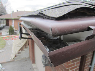 Hooded eavestrough system that needs to be replaced