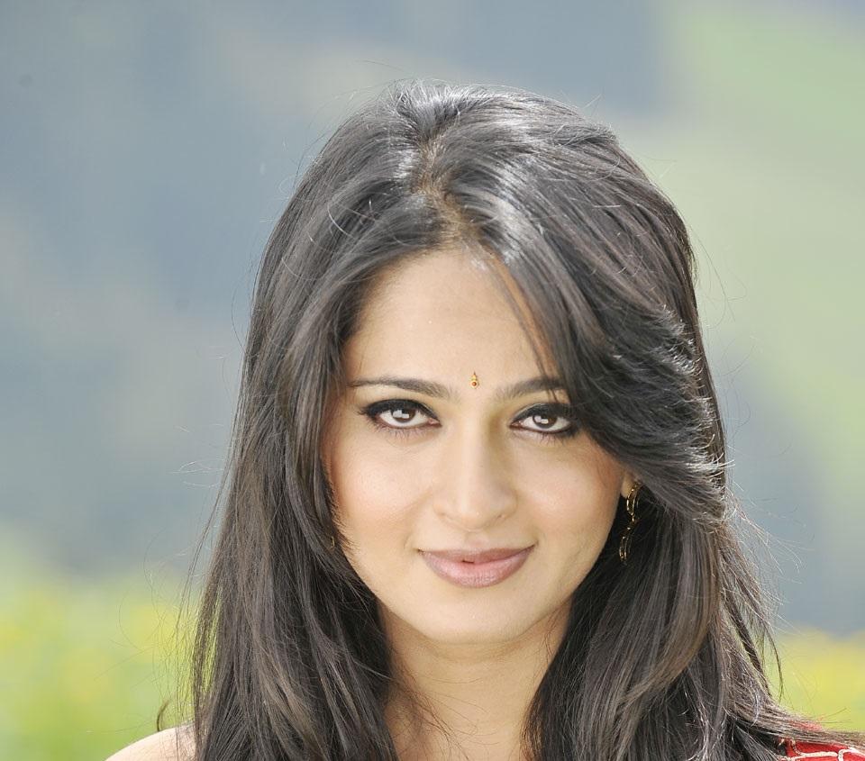 Indian Actress Anushka Shetty Stills In Red Saree