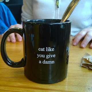 eat like you give a damn mug