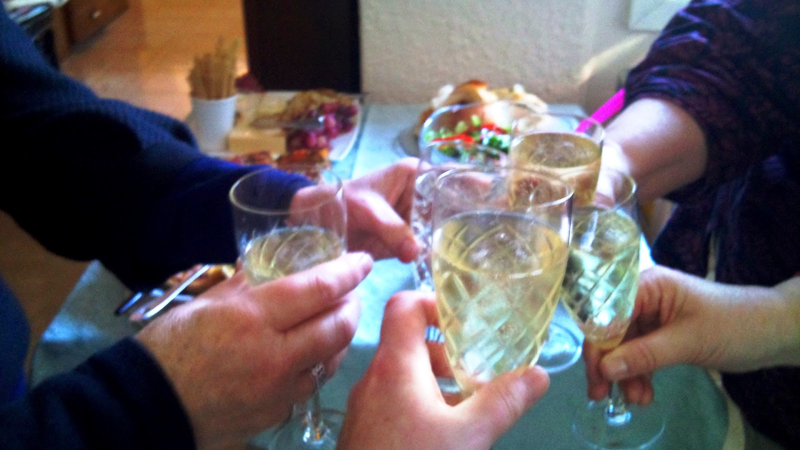 Five glasses of sparking wine toasting.