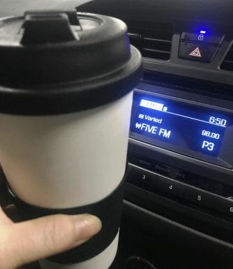 Coffee cup with Five FM selected on car radio tuner