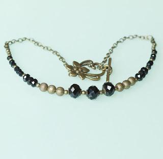 https://www.alittlemarket.com/collier/fr_collier_elegant_gatsby_noir_et_bronze_-17819386.html