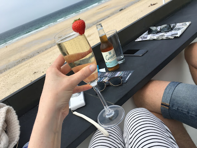 Prosecco overlooking Porthmeor Beach St Ives, Cornwall