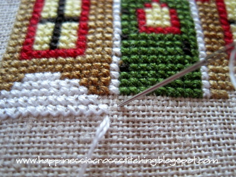Cross stitching two over two on linen
