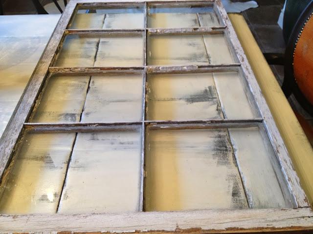transform an old window pane into an art piece