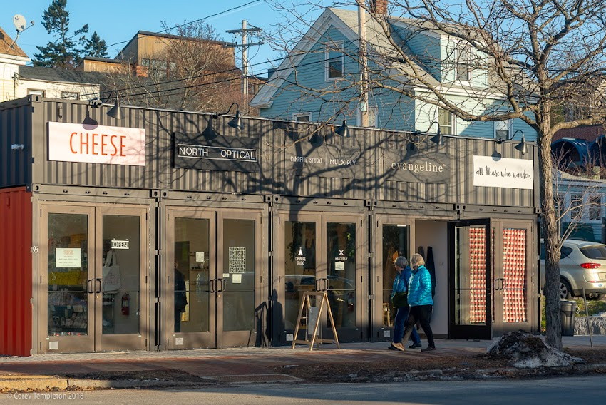 Portland, Maine USA December 2018 photo by Corey Templeton. Strolling past the The Black Box on Washington Ave, home to five unique small (literally!) businesses. The flexible 300 square foot units are built out of repurposed shipping containers and can be leased month-to-month.