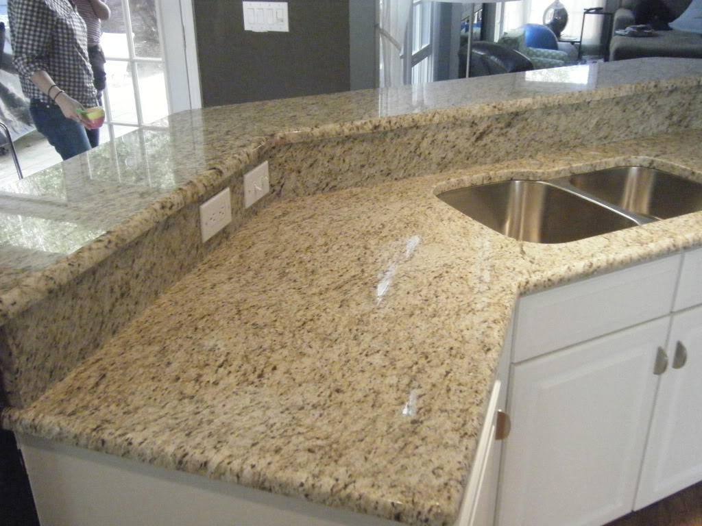 Grainte Countertop With Matching Backsplash For Kitchen