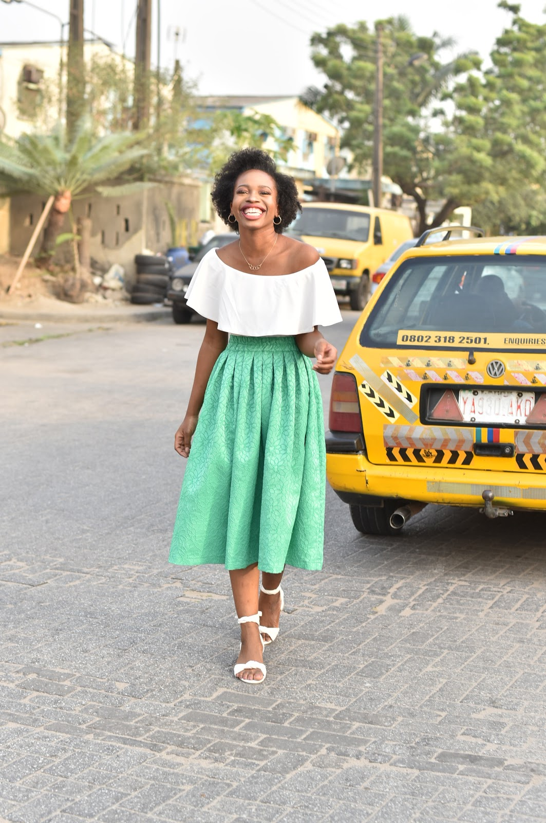 Nigerian Fashion Blogger smiling on the streets of Lagos