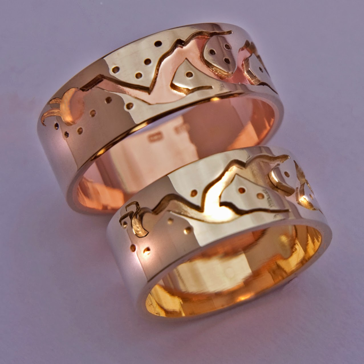 Mishi-ginebig design wedding bands by Native Woodland jeweler Zhaawano Giizhik