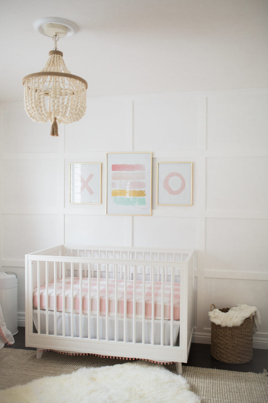 white and pink baby girl nursery