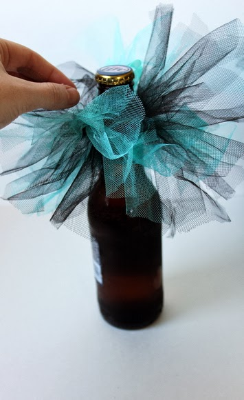 These ribbon and tulle beer skirts are re-usable, so when you finish a beer just pop it onto a freshly opened bottle!