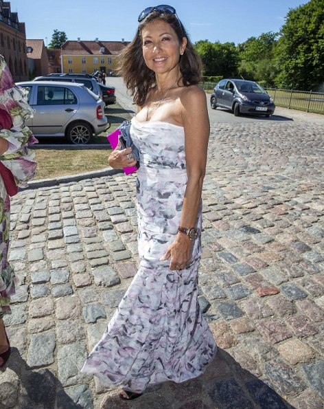 Princess Marie wore a new floral print skirt by Ganni.Prince Joachim, Princess Marie, Prince Felix and Countess Alexandra at graduation party