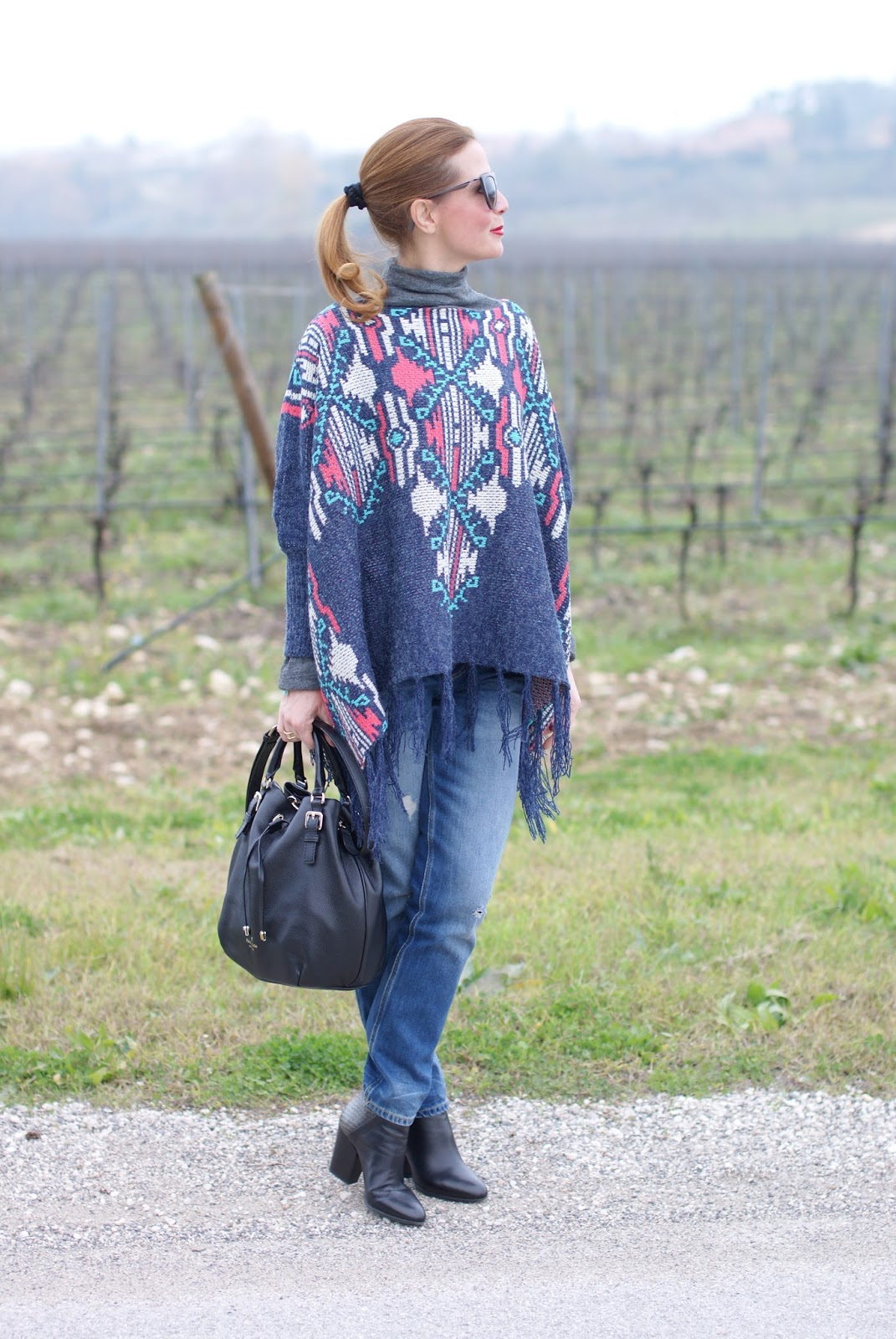 LucLuc Fringed aztec cape and poncho for a western inspired outfit on Fashion and Cookies fashion blog, fashion blogger style