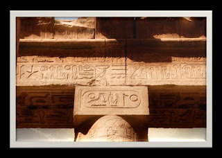 Hieroglyphics chiseled on stone block at the top of column