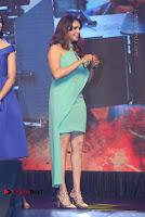 Actress Isha Koppikar Pos in Green Dress at Keshava Telugu Movie Audio Launch .COM 0046.jpg