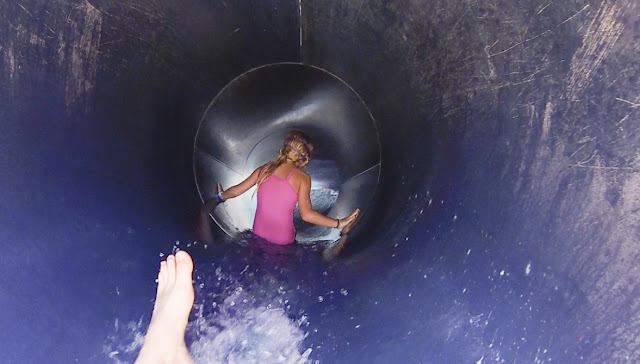 Little girl slides down water slide at Adventure Landing