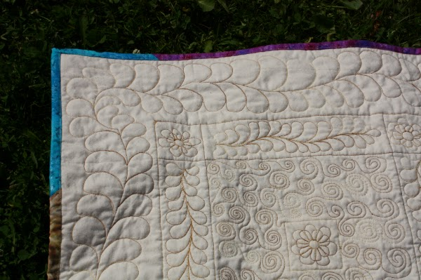 Free motion quilting feathers and swirls