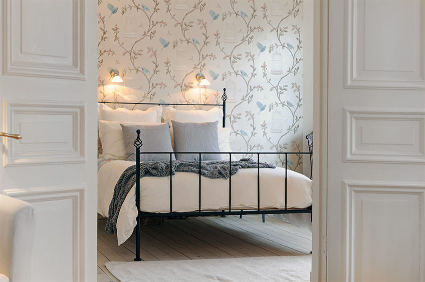 Gorgeous Swedish style bedroom with neutral romantic decor in Stockholm apartment