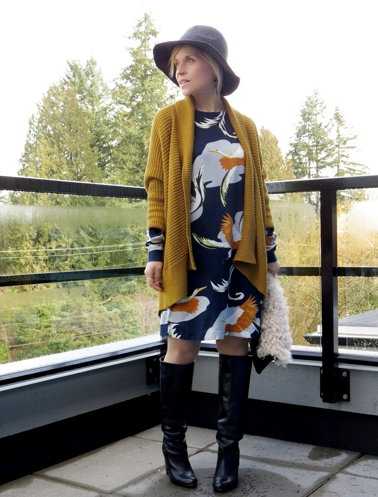 Sparks:  printed dress, drapey cardigan, knee boots, and floppy hat