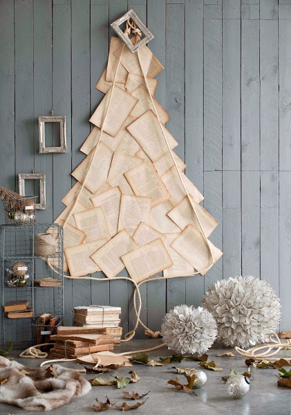 http://decoracion.facilisimo.com/blogs/general/arboles-de-navidad-en-la-pared_964579.html