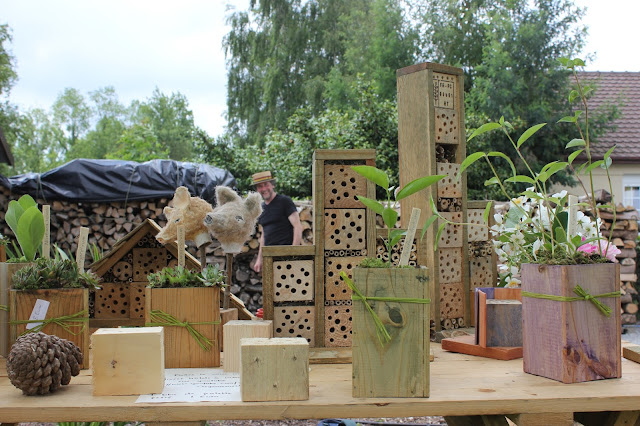 Insect houses and planters from repurposed wood