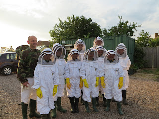 the scouts all kitted out and ready to visit the hives