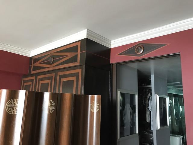 Diamond and medallion above WC door