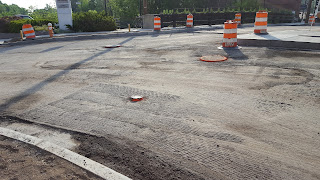 street milled of the top layer of asphalt in preparation for laying down the final coat