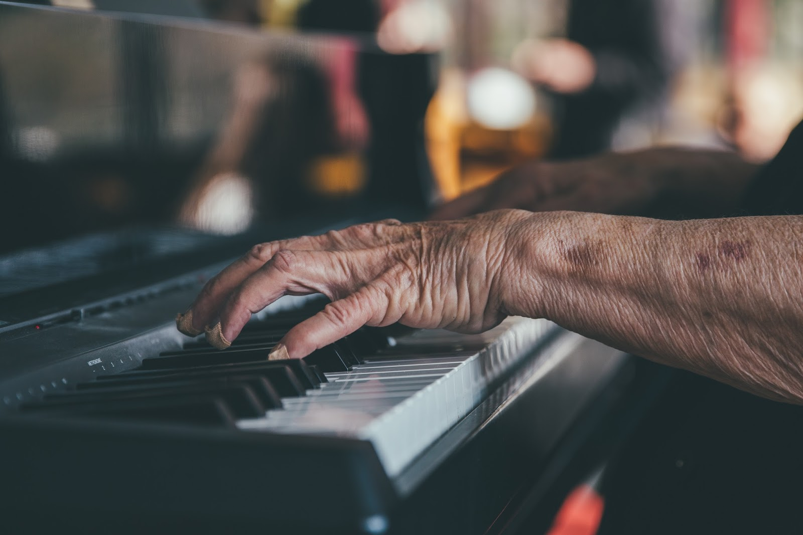 Hands of an old lady playing the piano