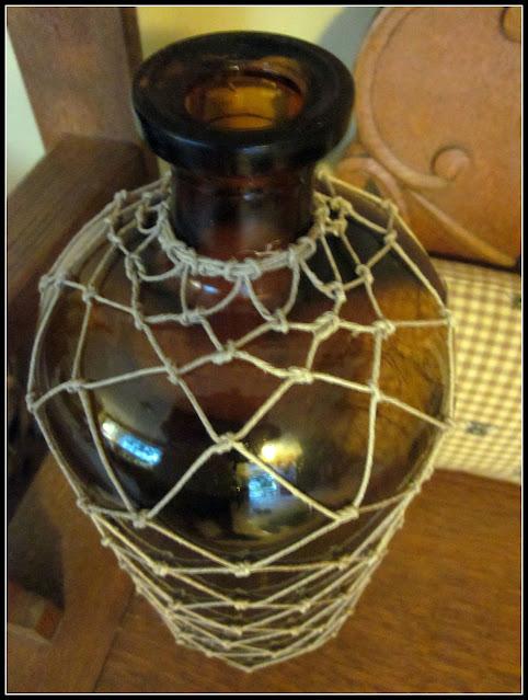 Macrame string in knots around bottle