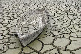 http://pixabay.com/en/old-ship-mud-broken-abandoned-sad-164980/