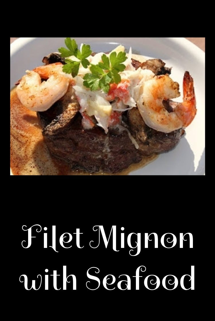 this is a grilled filet mignon piece of gourmet tender filet topped with shrimp , crab and wine sauce on top