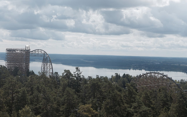Photo of Wildfire Roller Coaster Peaking Through Trees at Kolmarden Zoo in Sweden