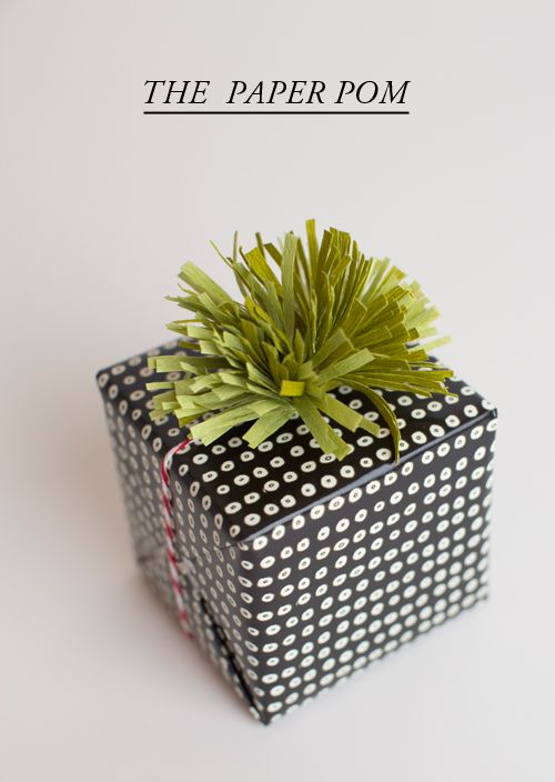Christmas gift wrapping - elegant black and white with green pom top