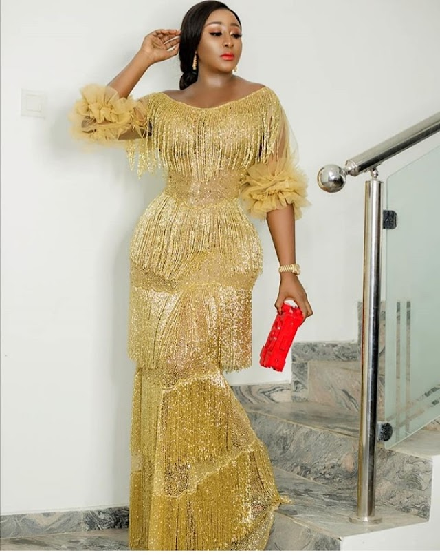 Ini Edo wows in a trickle Classic Gold Dress