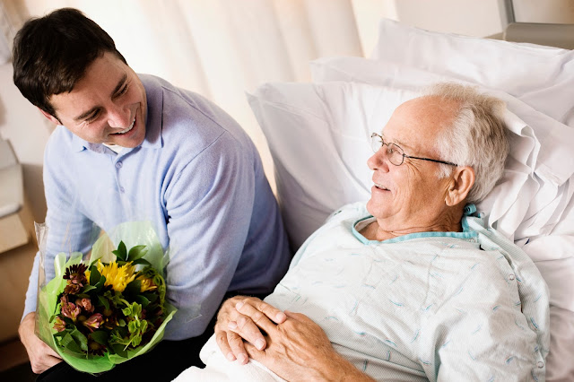 Man visiting his father in the hospital