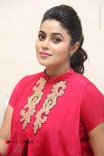 Actress Poorna Latest Stills in Red Dress at Rakshasi First Look Launch  0224.JPG