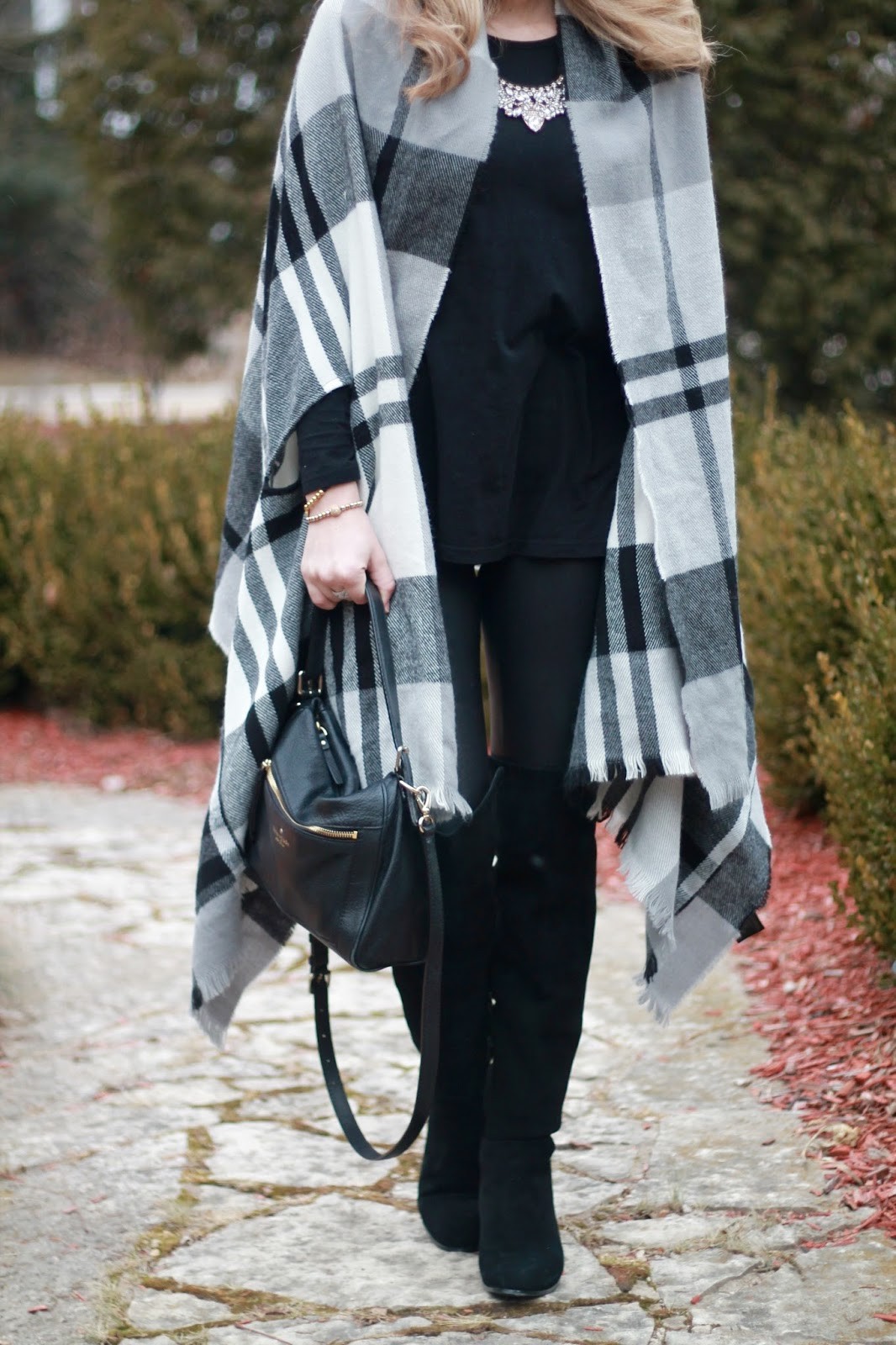black and white plaid poncho, black tee, spanx leather leggings, black OTK boots, black kate spade crossbody bag