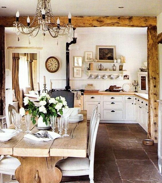 French farmhouse kitchen with rustic farm table, Swedish chairs, and white cabinets on Hello Lovely Studio #Frenchfarmhouse #FrenchKitchen #NordicFrench