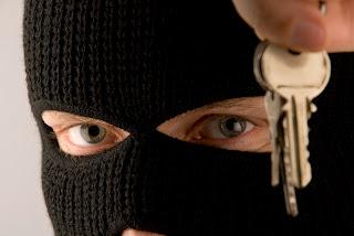 burglar holding keys