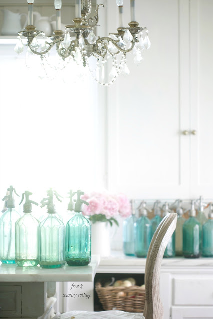 White kitchen with vintage seltzer bottles