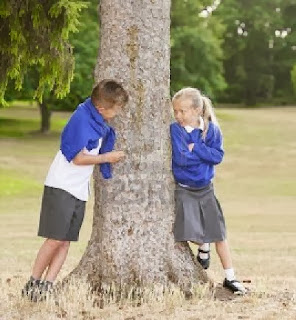 boy-and-girl-talking-beside-a-tree-cute-love